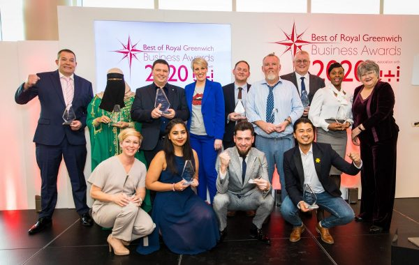Thirteen people pose at the Best of Business Awards