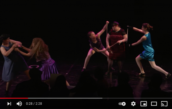 Screen shot of dancers performing on stage
