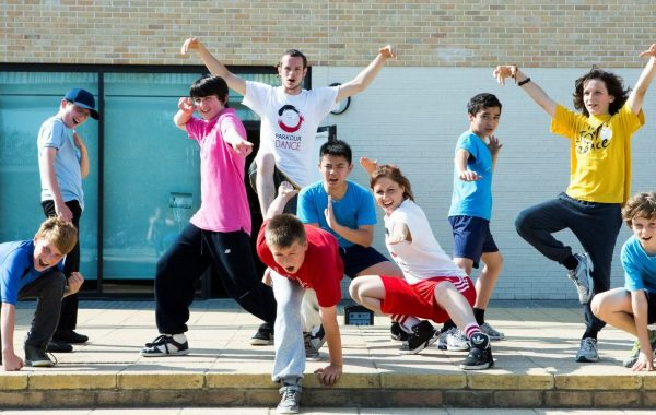 A group of young people in a school playground
