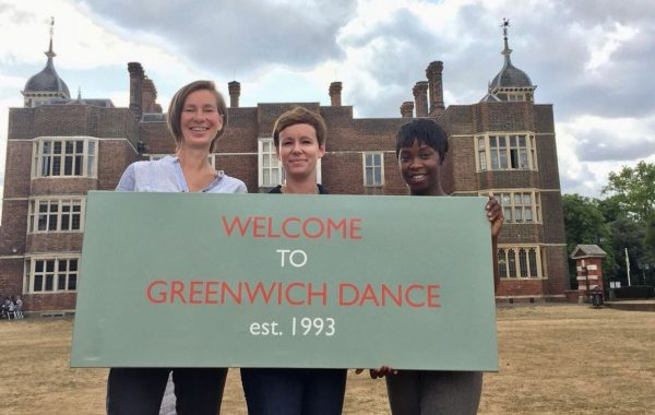 Ragnhild, Melanie and Chenube stand in front of their new home, Charlton House