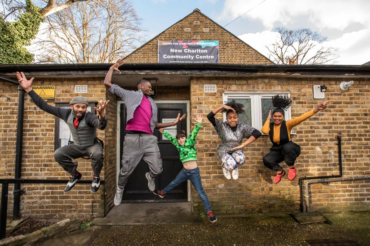 Five people jumping in front of New Charlton community centre