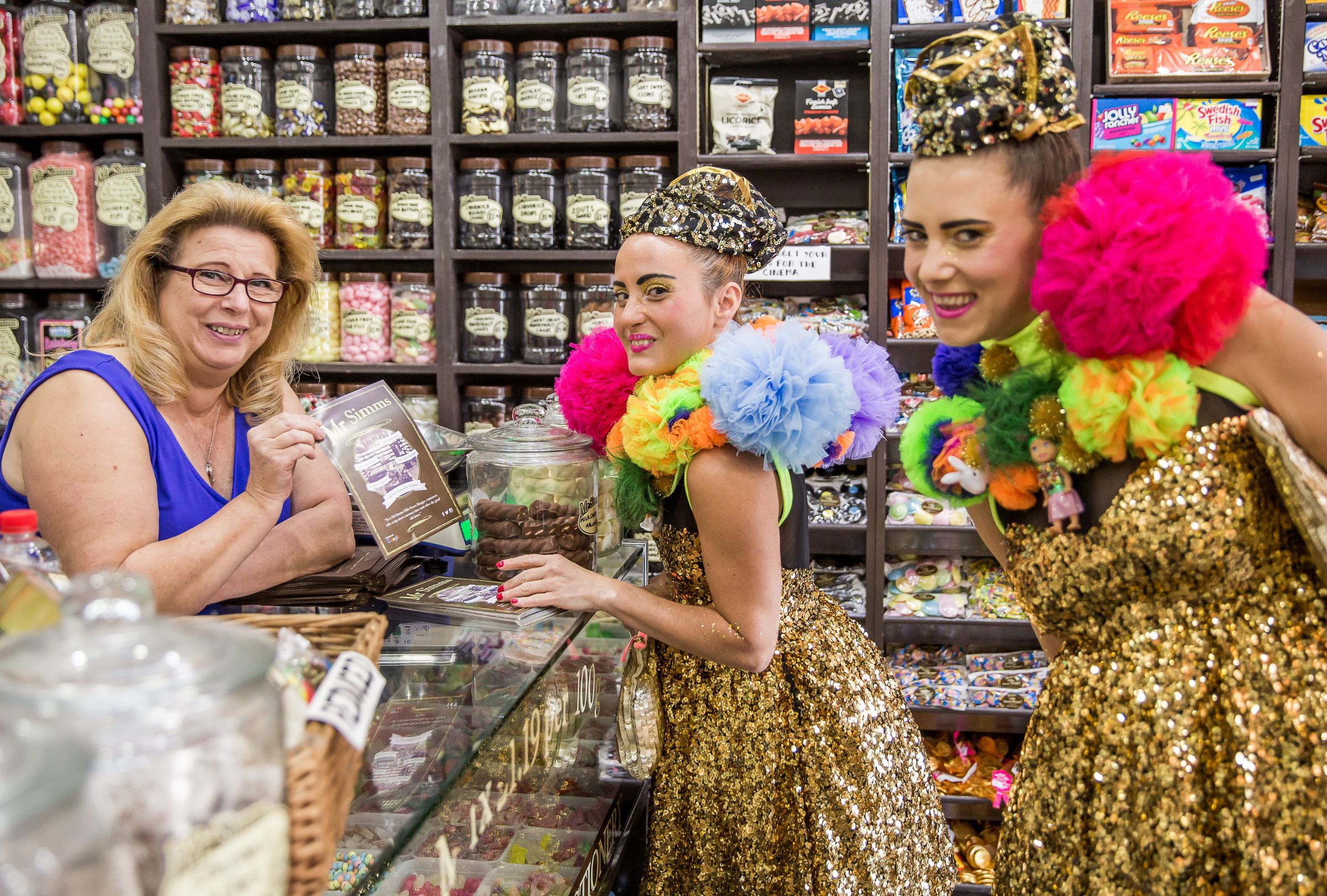 Two performers visit a sweet shop