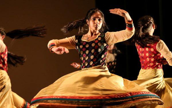 Three dancers in South Asian costume performing