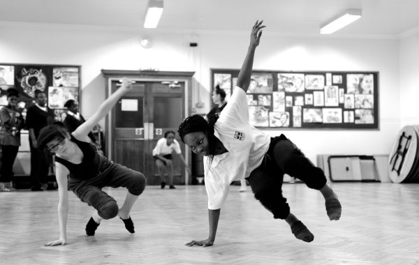 A black and white image of two young people dancing