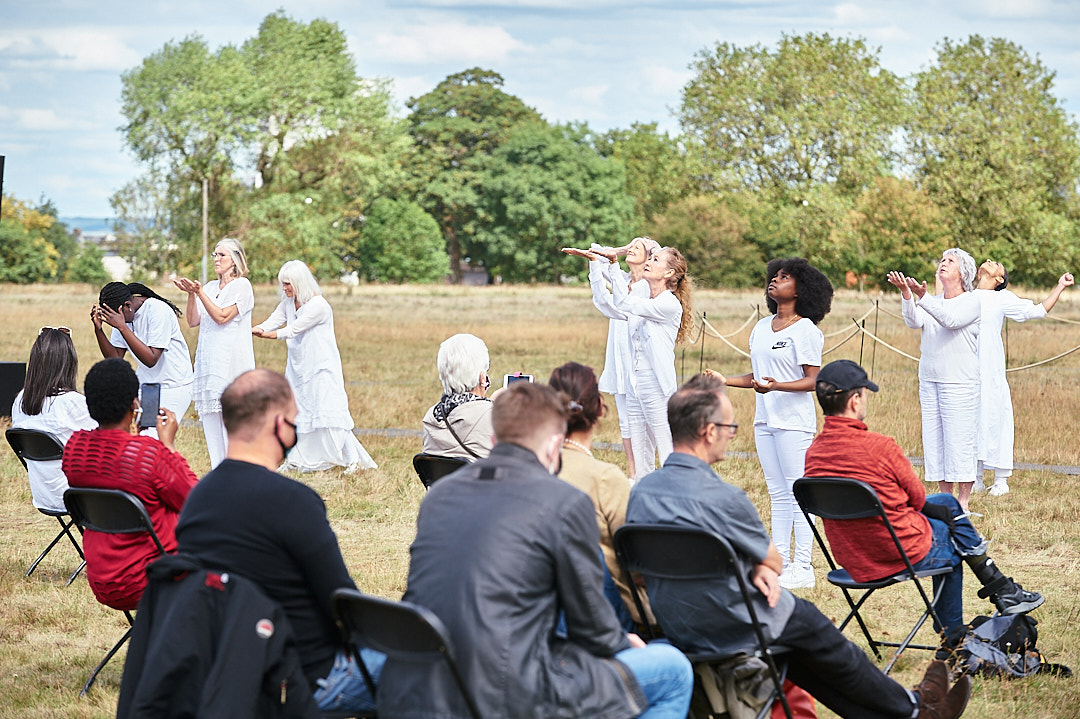 intergenerational performance group performing at GDIF in white clothing
